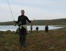 Harald har tatt en flott kilos ørret på fluestanga. Foto: Evald Bjerkli